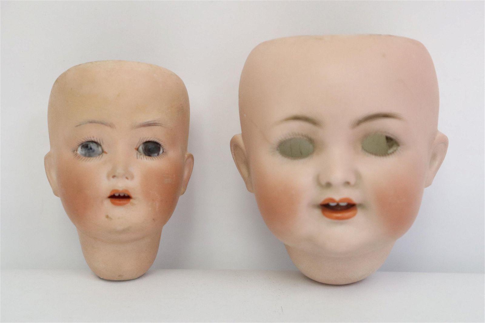 2 German antique bisque doll heads, hairline