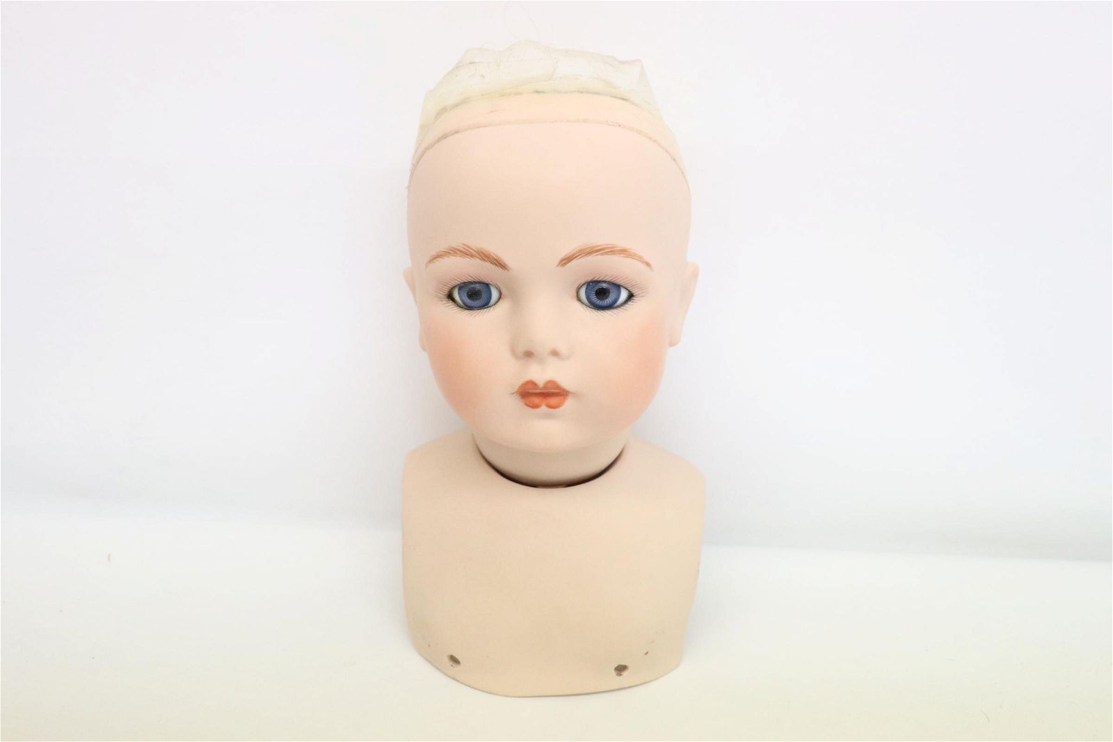 A large bisque doll head