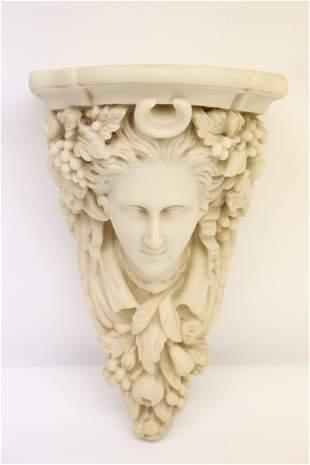 A casted wall shelf in figure motif