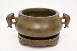 A very heavy Chinese handled bronze censer with bronze