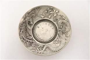 A small Chinese white bronze dish