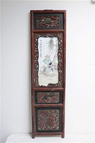 A framed Chinese porcelain plaque