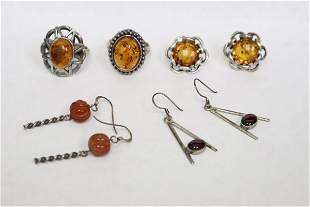 2 sterling rings & 3 pr earrings w/ amber like stone