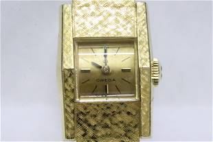 18K ladies Omega wrist watch w/ 18K band