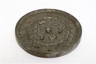 Large round bronze mirror