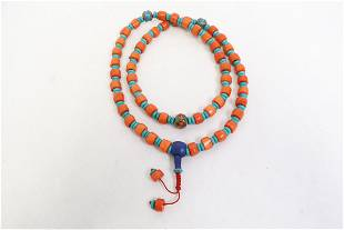 A simulated coral bead necklace