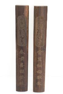 2 rosewood scroll weights