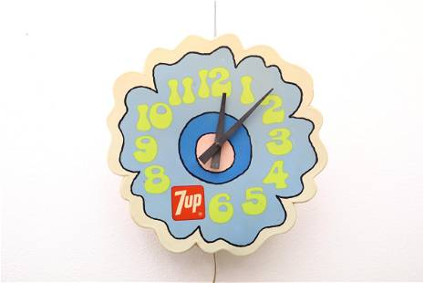 Plastic cased electric wall clock attributed to Peter
