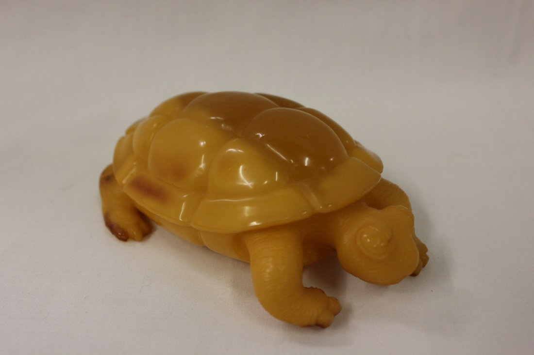 105: Natural amber carved turtle