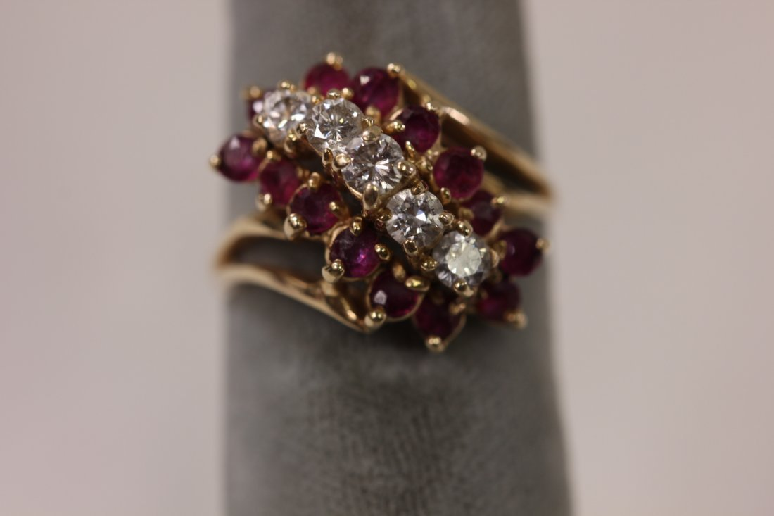 117: 14K Y/G diamond and ruby ring