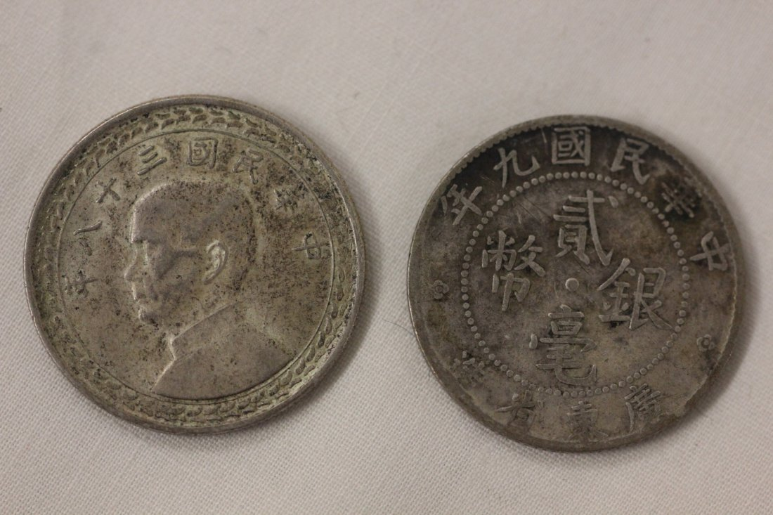 121: 2 Chinese silver coins
