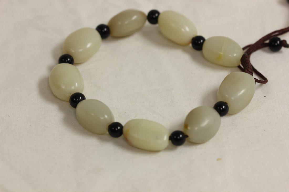 110: Chinese white pebble jade bead bracelet