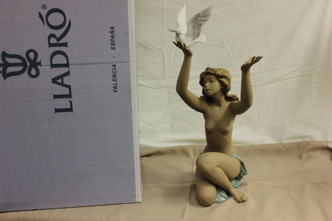 "614: Lladro sculpture ""girl with dove"""