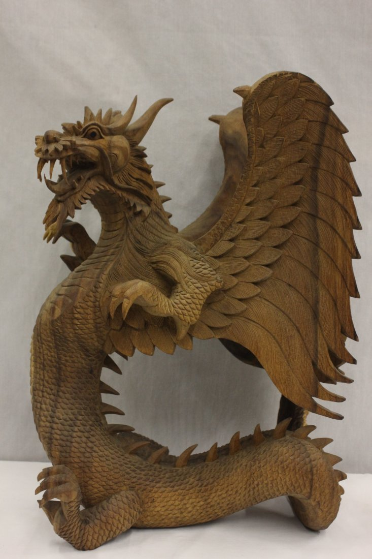 111: A fine wood carved winged dragon