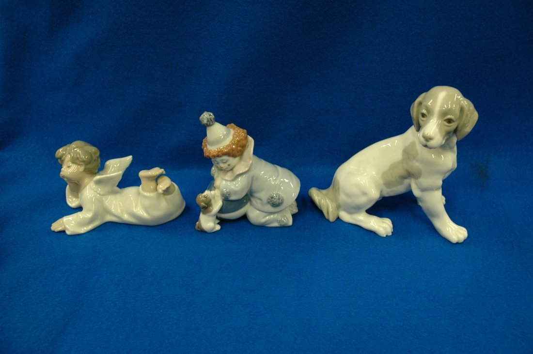 "2 Iladro figurines, and a ""dog"" figure by Dao"