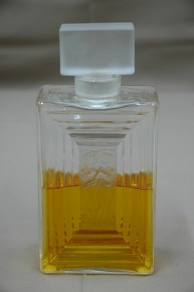 A large signed Lalique perfume bottle