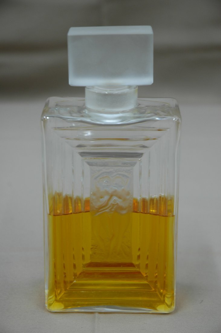 A large signed Lalique perfume bottle
