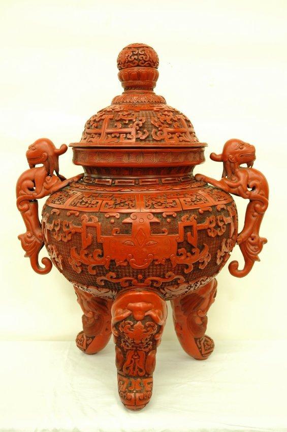 Chinese cinnabar covered jar in archaic bronze motif