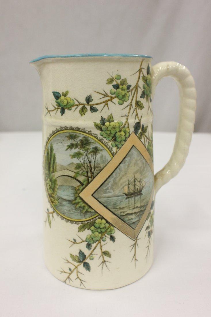 Antique hand painted porcelain pitcher