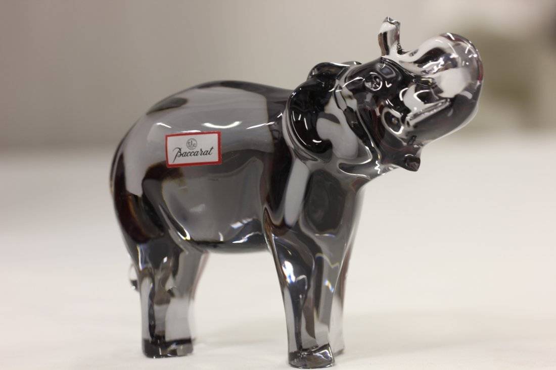 A tinted crystal elephant by Baccarat