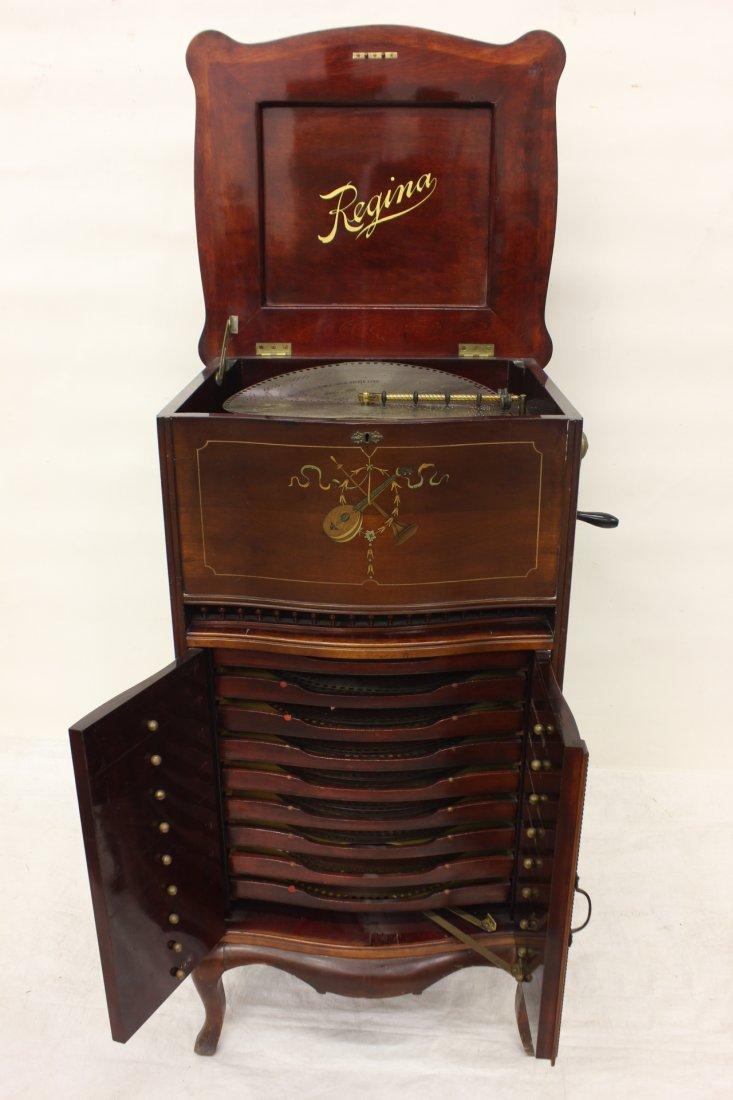 antique Regina disc player w/ disc storage cabinet