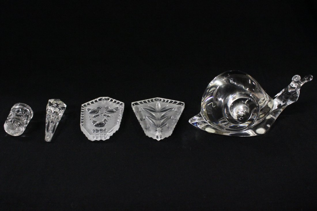 A Baccarat snail and 4 Waterford ornaments