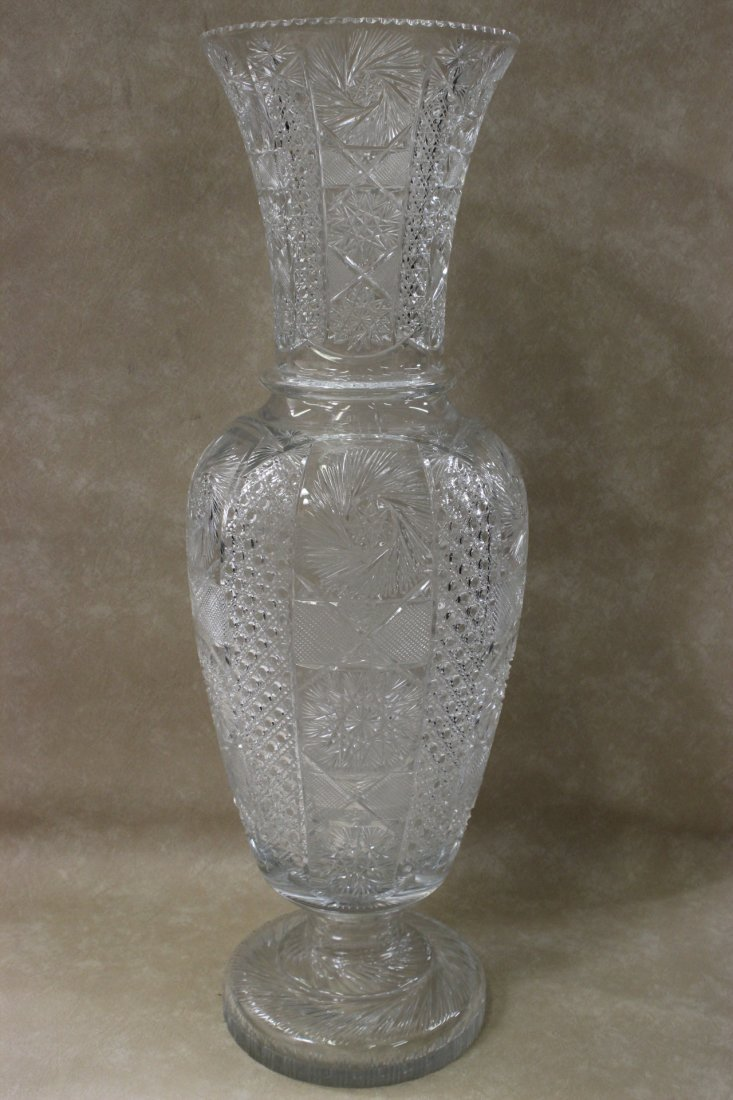 A large well cut crystal vase