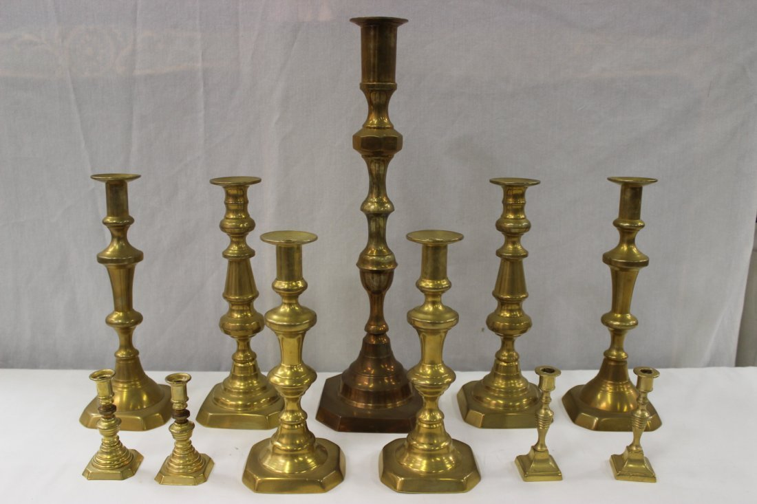 11 English antique brass candle holders