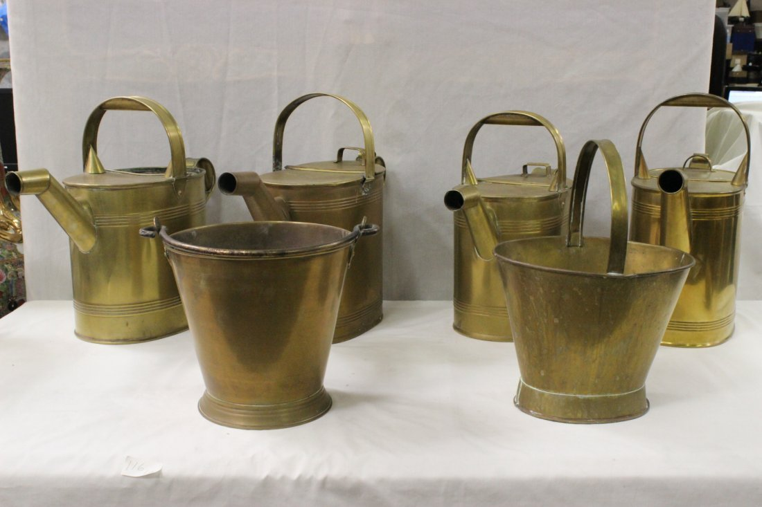 4 English brass watering canes, and 2 brass buckets