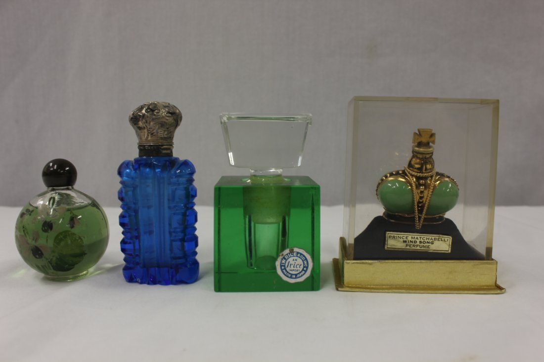 4 vintage perfume bottles, one with silver cap