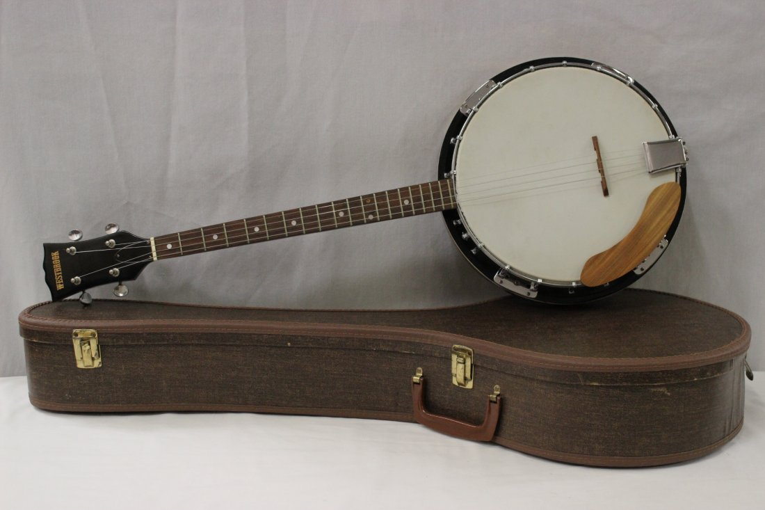A vintage banjo with case
