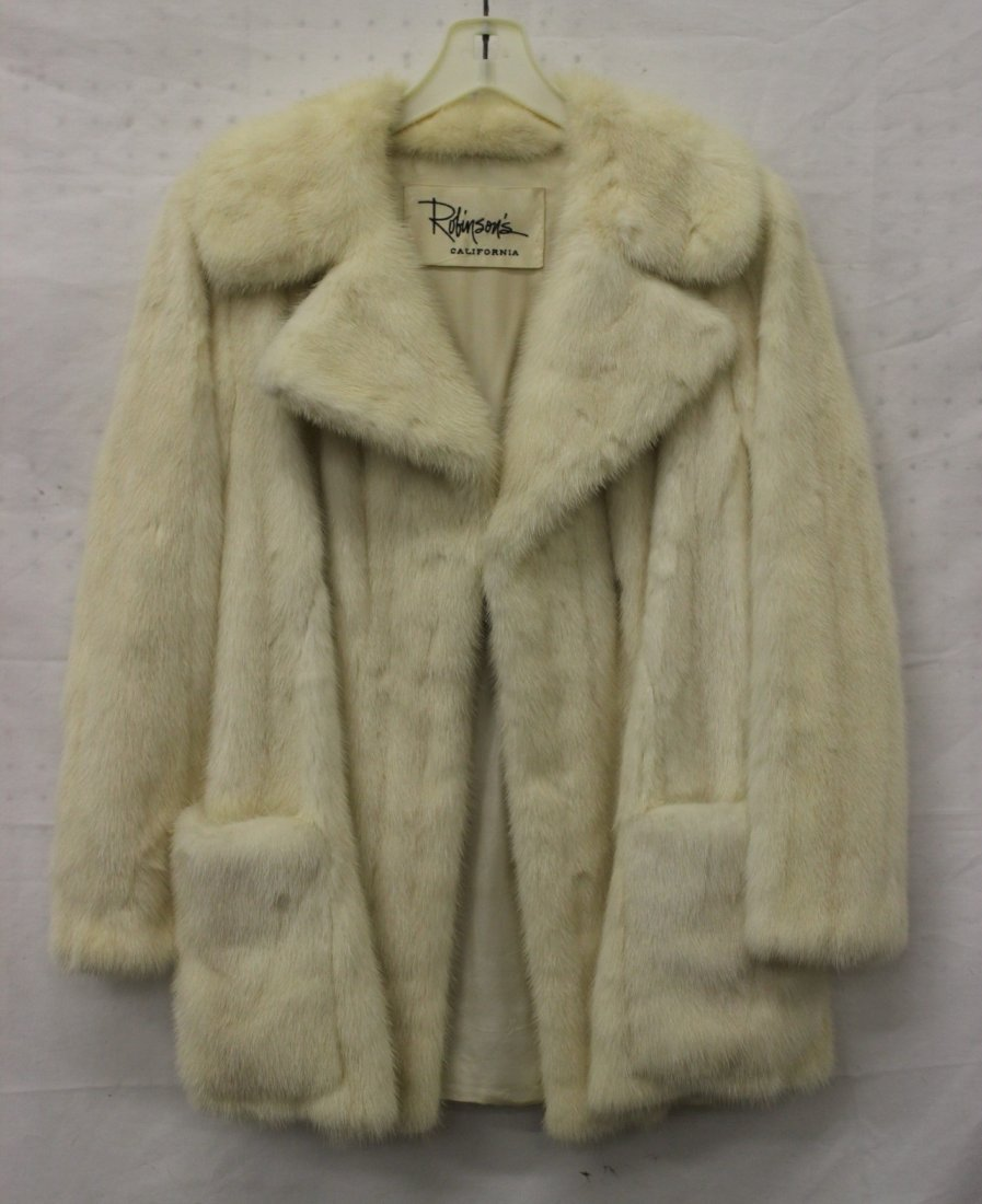 A fine dyed white half length mink coat