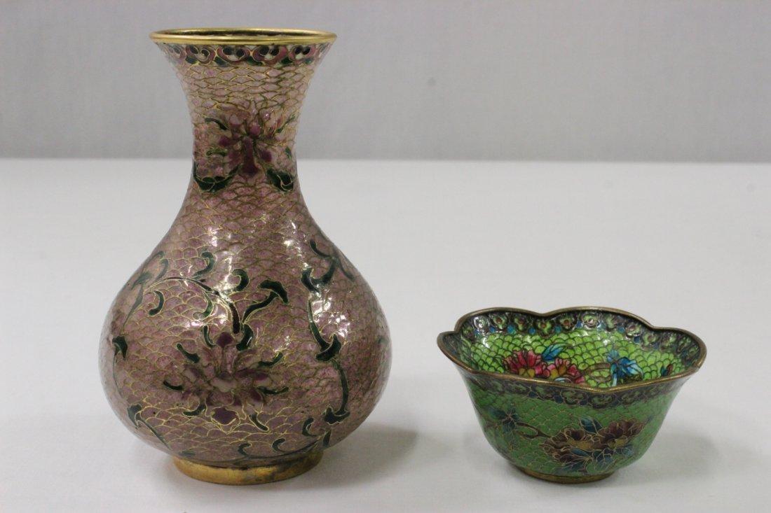 A plique a jour vase and a cup