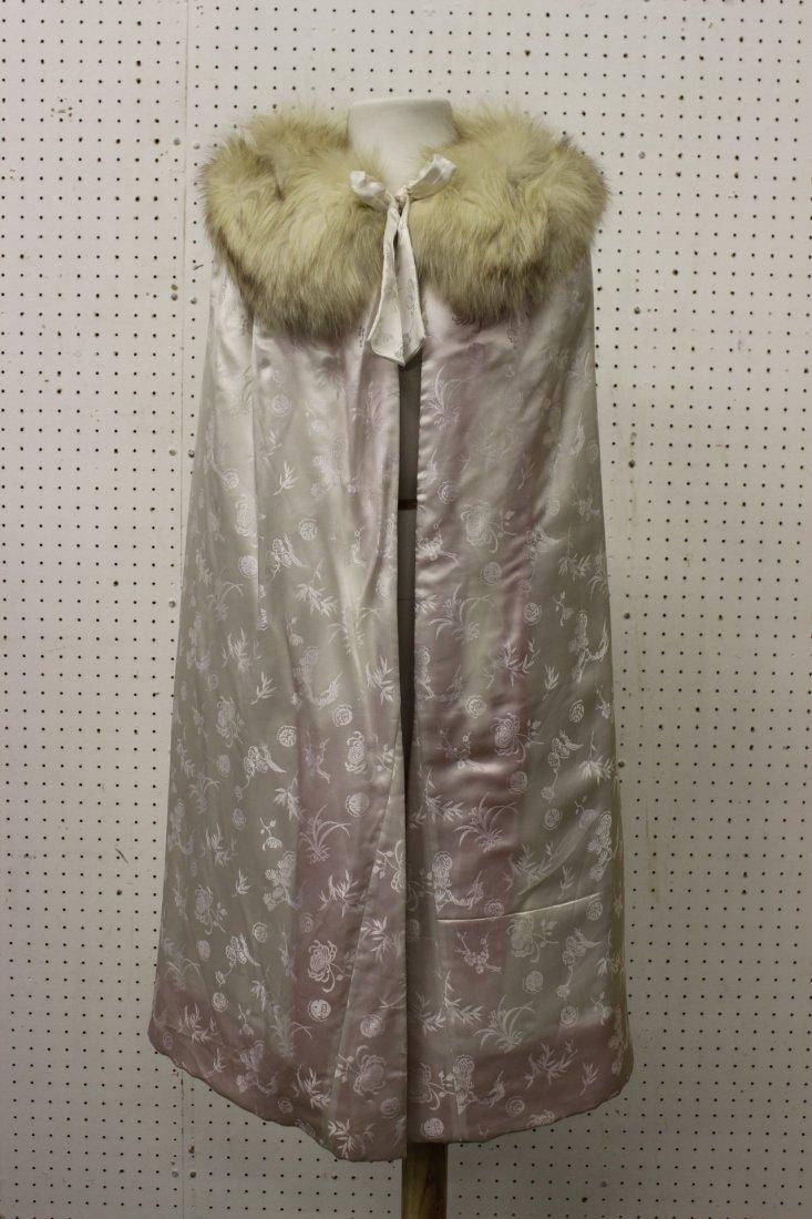 A full length cape with fox fur collar