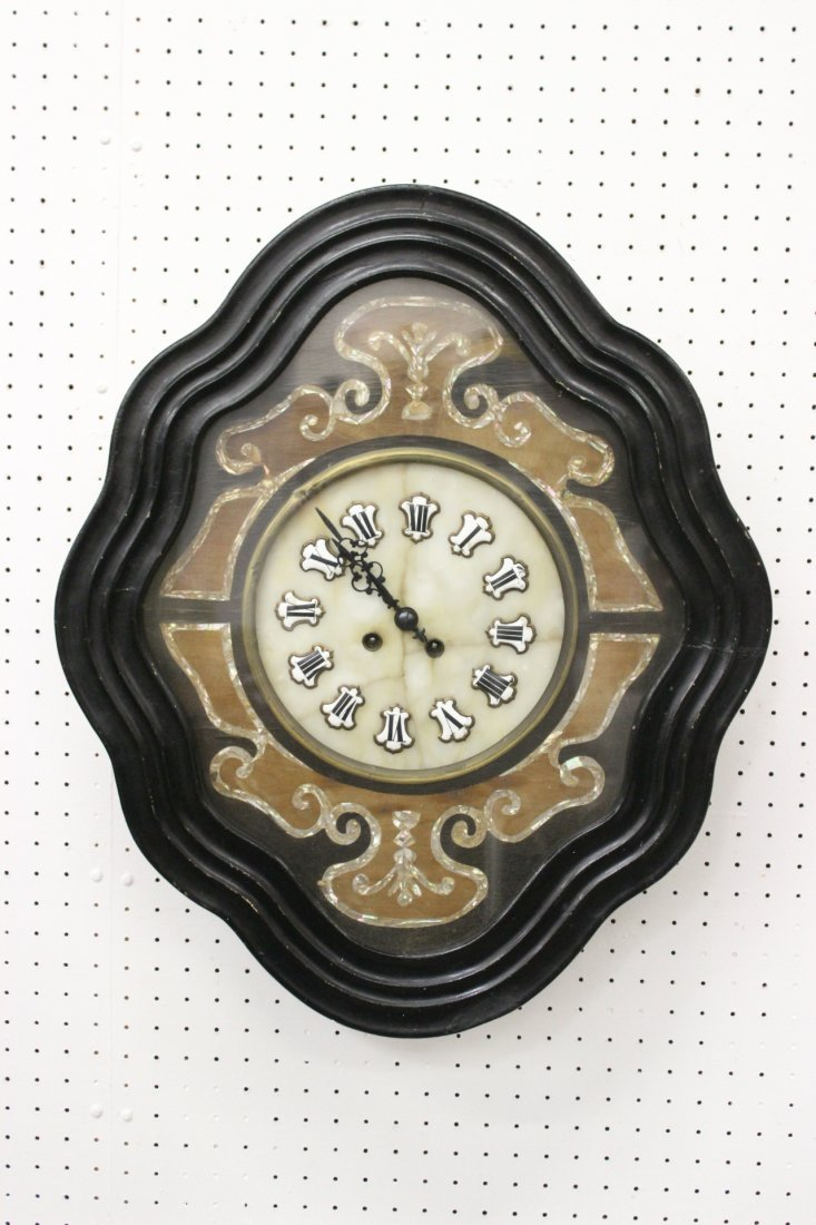 A French wall clock with mother of pearl inlaid