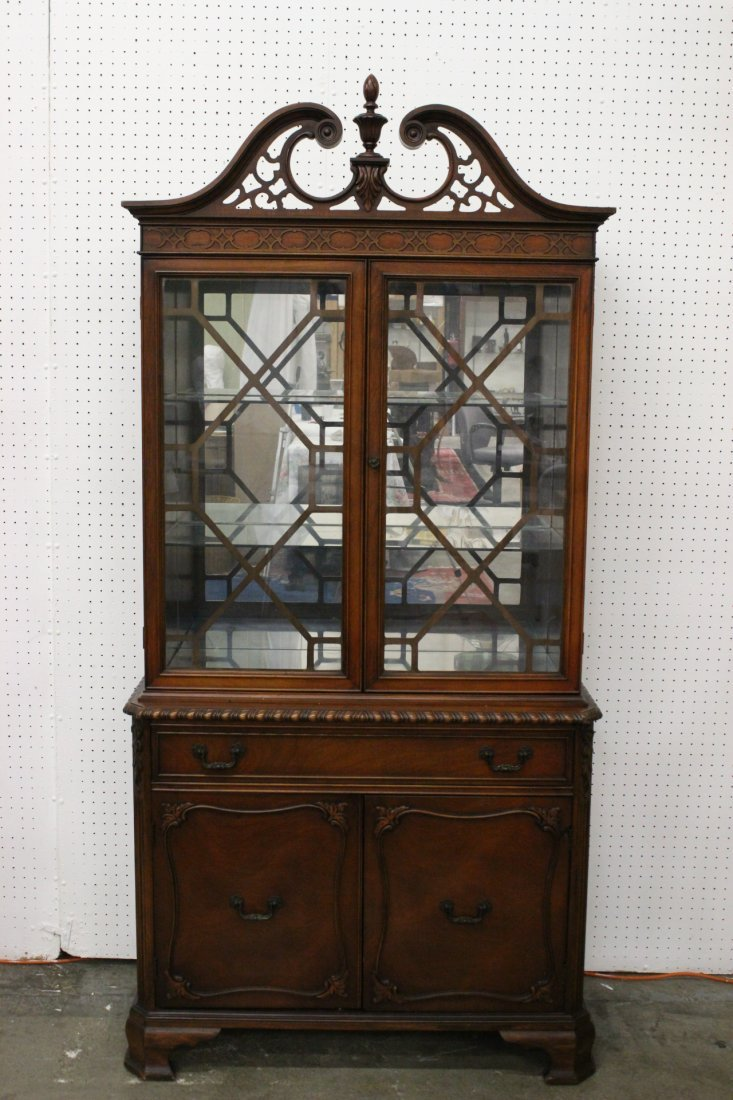 A fancy early 20th century mahogany china cabinet