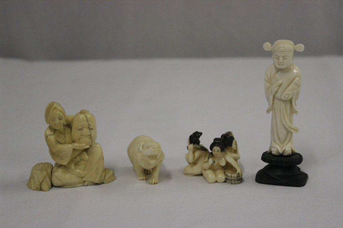 4 ivory carvings