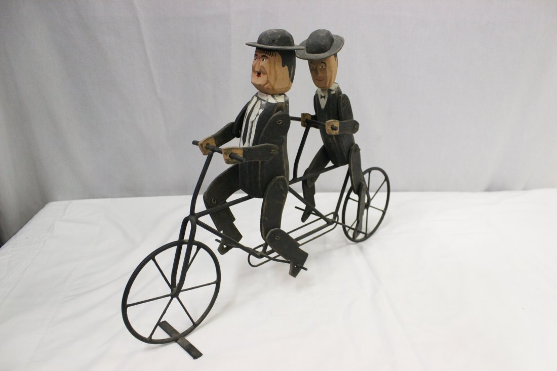 Cast iron bike with wood Laurel and Hardy