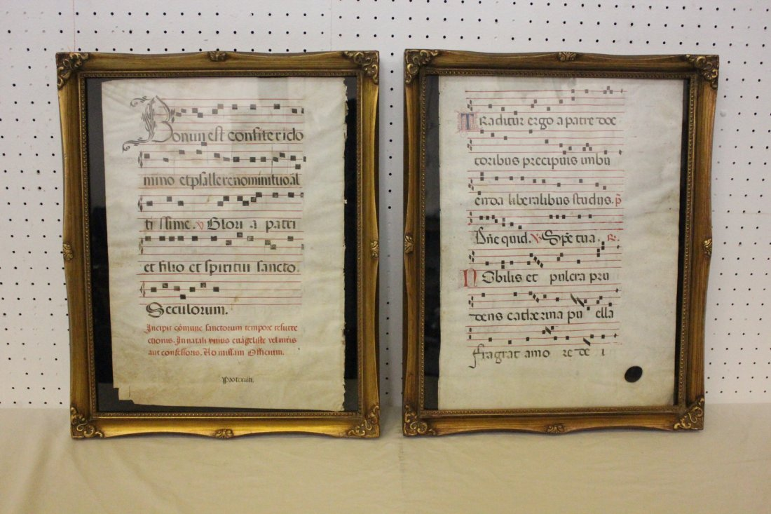 2 framed antique music notes on parchment paper