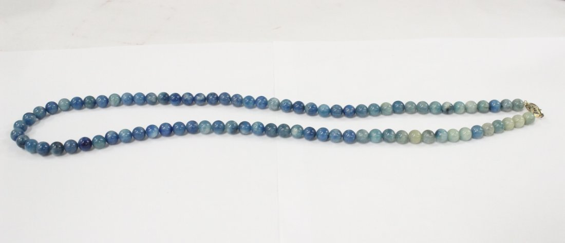 A rare Chinese blue jadeite bead necklace