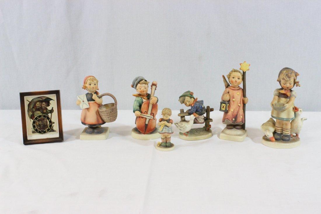 6 Hummel figures and a miniature Hummel clock