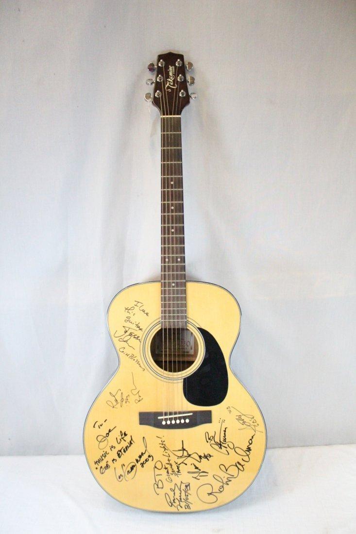 Autographed Takamine G-230 guitar