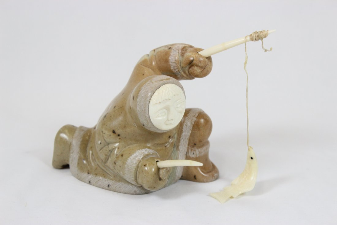 Eskimo stone carving with ivory finial