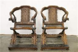 Pair Chinese hardwood folding armchairs