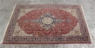 A large vintage Persian Mashad rug
