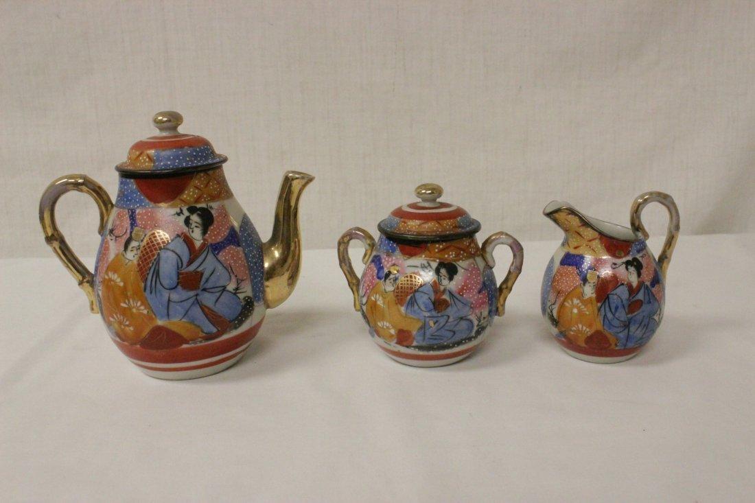 A Japanese Kutani tea set, and a Kutani sake set - 9