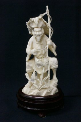 A Fine Ivory Carved Fisherman