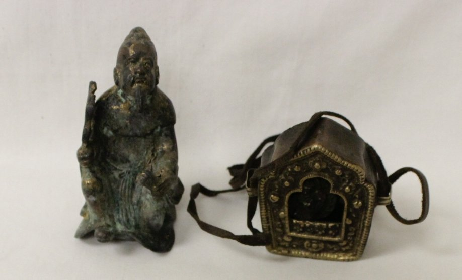 A small bronze figure and a religious ornament