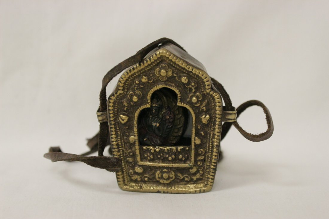 A small bronze figure and a religious ornament - 2