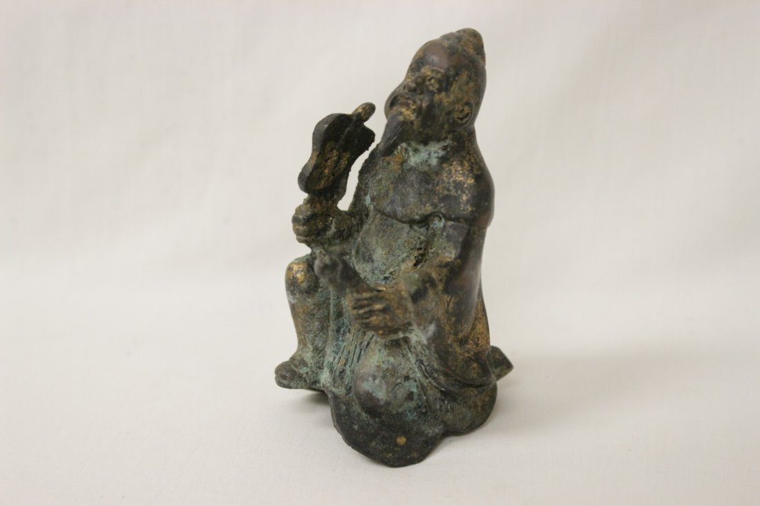 A small bronze figure and a religious ornament - 7